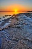 Beautiful sunrise on salt lake Chott el Djerid, Sahara desert, T Stock Photos
