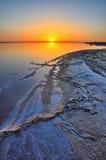Beautiful sunrise on salt lake Chott el Djerid, Sahara desert, T Stock Photography