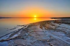 Beautiful sunrise on salt lake Chott el Djerid, Sahara desert, T Stock Image