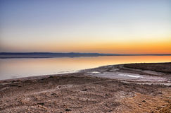 Beautiful sunrise on salt lake Chott el Djerid, Sahara desert, T Royalty Free Stock Photography