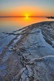 Beautiful sunrise on salt lake Chott el Djerid, Sahara desert, T Stock Images