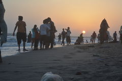 Beautiful sunrise scene at beach with people. And camel Stock Photos