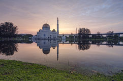 Beautiful sunrise scenery of As-Salam Mosque located in Selangor, Malaysia with reflecton on the lake. Color toning applied stock photography