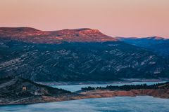Beautiful sunrise scenery of mountains in Tous, Spain with river in foreground.  royalty free stock photo