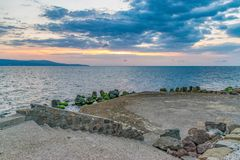 Beautiful sunrise at sea with dramatic clouds in Nessebar ancient city. Nesebar, Nesebr is a UNESCO World Heritage Site. Sunrise. In Nessebar, Bulgaria black royalty free stock photos