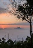 Beautiful sunrise with sea of fog over mountain Stock Photo