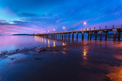 Beautiful sunrise at the sea pier Stock Image