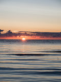 Beautiful sunrise in the sea at the wild beach Stock Photography