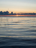 Beautiful sunrise in the sea at the wild beach Royalty Free Stock Images