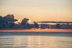 Beautiful sunrise in the sea at the wild beach Royalty Free Stock Image
