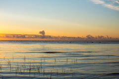 Beautiful sunrise in the sea at the wild beach Stock Images