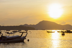Beautiful sunrise seascape view with boat in phuket island. Royalty Free Stock Photo