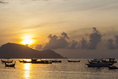 Beautiful sunrise seascape view with boat in phuket island. Royalty Free Stock Photos