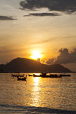 Beautiful sunrise seascape view with boat in phuket island. Stock Photo