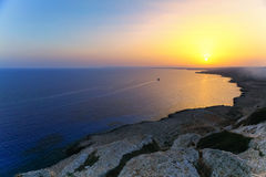 Beautiful sunrise with ship on the sea on Aya Napa, Cyprus. Stock Image