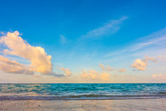 Beautiful sunrise with sky over calm sea  in tropical Maldives i. Sland Stock Image