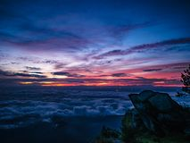 Beautiful Sunrise Sky with Rocky cliff in the morning on Khao Luang mountain in Ramkhamhaeng National Park. Sukhothai province Thailand stock photography