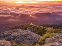 Beautiful Sunrise Sky with Sea of the mist of fog and Small Golden pagoda in the morning on Khao Luang mountain. In Ramkhamhaeng National Park,Sukhothai royalty free stock photography