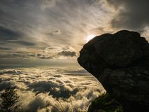 Beautiful Sunrise Sky with silhouette Rocky cliff in the morning on Khao Luang mountain in Ramkhamhaeng National Park. Sukhothai province Thailand stock photo