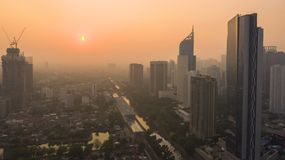 Beautiful sunrise with skyscrapers in Jakarta. JAKARTA, Indonesia - October 26, 2018: Beautiful aerial view of sunrise time with skyscrapers near the BNI City stock images
