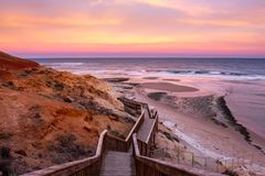 A beautiful sunrise at southport port noarlunga south australia overlooking the wooden staircase ocean and cliffs on the 30th. April 2019 royalty free stock photos