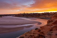 A beautiful sunrise at southport port noarlunga south australia overlooking the wooden staircase ocean and cliffs on the 30th. April 2019 stock image