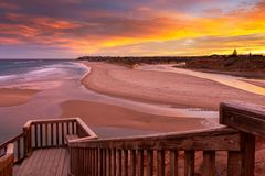 A beautiful sunrise at southport port noarlunga south australia overlooking the wooden staircase ocean and cliffs on the 30th. April 2019 stock photo