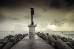 Beautiful sunrise sunset  on the concrete wall.light house structure surrounded by concrete breakwater, Stock Photo
