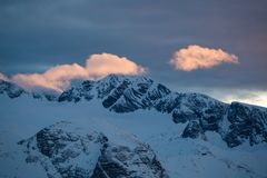 Beautiful sunrise on the top of high mountains in Austria. royalty free stock photography