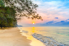 Beautiful sunrise on the tropical beach with a little waves Royalty Free Stock Image