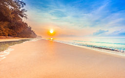 Beautiful sunrise on the tropical beach with a little waves Royalty Free Stock Photo