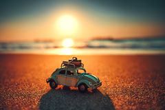 Beautiful sunrise on tropical island beach and car miniature stock photo