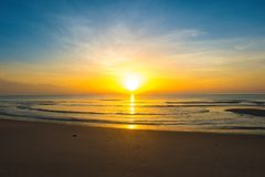 Beautiful sunrise on tropical sand beach. Beautiful sunrise on tropical sand beach, Morning sunshine of bright day on beach Royalty Free Stock Photography