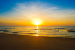 Beautiful sunrise on tropical sand beach. Beautiful sunrise on tropical sand beach, Morning sunshine of bright day on beach Stock Images