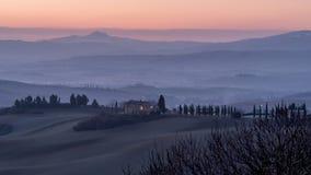 Beautiful sunrise on the Tuscan hills between San Quirico d`Orcia and the Rocca di Radicofani, Siena, Italy royalty free stock image