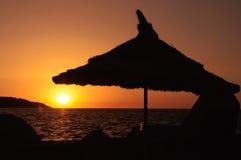 Beautiful sunrise under the umbrella Stock Images