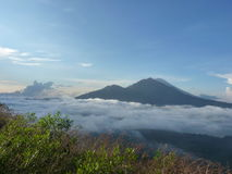 Beautiful sunrise on the volcano. View of Agung volcano from the peak of Batur. Stock Photo