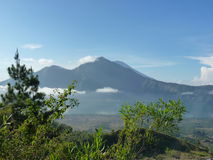 Beautiful sunrise on the volcano. View of Agung volcano from the peak of Batur. Royalty Free Stock Image