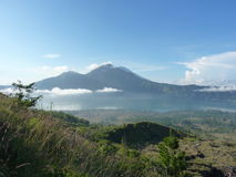 Beautiful sunrise on the volcano. View of Agung volcano from the peak of Batur. Stock Photos