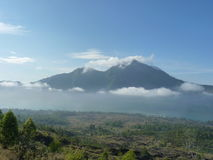 Beautiful sunrise on the volcano. View of Agung volcano from the peak of Batur. Royalty Free Stock Images