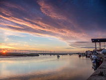 Beautiful Sunrise at Wells Harbour Norfolk. Sunrise lighting up boat moorings and the town at high tide. Wells-next-the-Sea Norfolk stock image