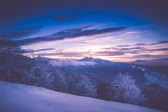 Beautiful sunrise in the winter mountains. Filtered im royalty free stock photography