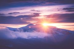 Beautiful sunrise in the winter mountains. Filtered im stock image