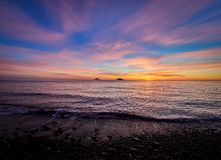 Beautiful sunrise withe the Stromboli and Panarea islands seen from the Salina island in the Aeolian islands, Sicily, Italy.  Stock Photo