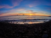 Beautiful sunrise withe the Stromboli and Panarea islands seen from the Salina island in the Aeolian islands, Sicily, Italy.  Royalty Free Stock Photos