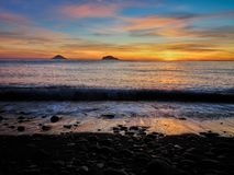 Beautiful sunrise withe the Stromboli and Panarea islands seen from the Salina island in the Aeolian islands, Sicily, Italy.  Royalty Free Stock Photography