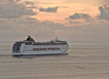 Beautiful sunset. And cruise line ship leaving the city of santos in brazil royalty free stock photography