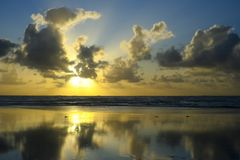 Beautiful sunset. On the sea with clouds royalty free stock image