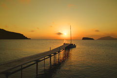 Beautiful sunset. Over a wooden pier in a Greek island Stock Photography