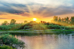 Beautiful sunset above a big river Royalty Free Stock Image